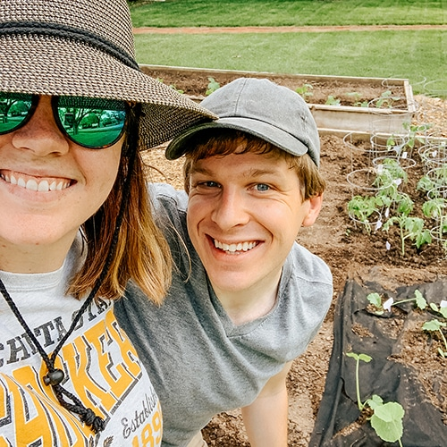 jared and alyssa planting the garden